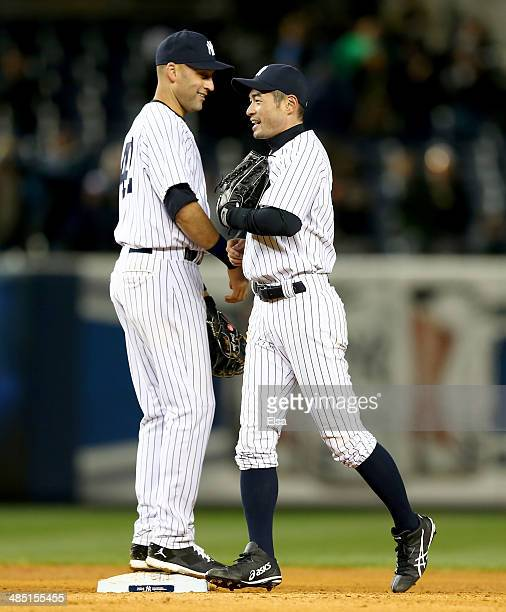 Derek Jeter and Ichiro Suzuki of the New York Yankees celebrate the win after game two of a doubleheader on April 16 2014 at Yankee Stadium in the...