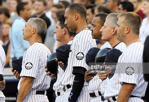 Derek Jeter and manager Joe Girardi of the New York Yankees observe a moment of silence during the ceremony for owner George Steinbrenner and Yankee...