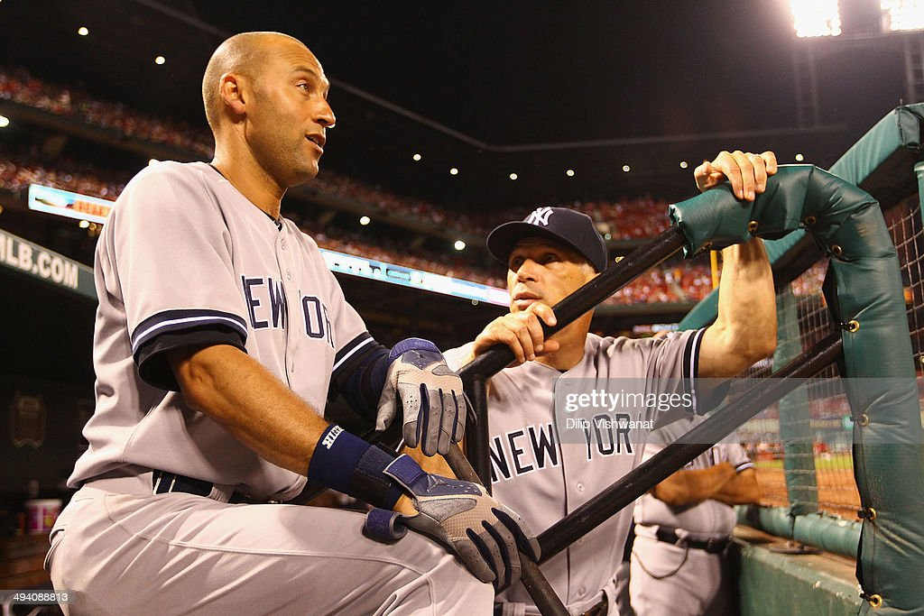 Derek Jeter #2 and manager Joe Girardi #28 of the New York Yankees talk while Jeter waits to bat against the St. Louis Cardinals at Busch Stadium on May 27, 2014 in St. Louis, Missouri. The Cardinals beat the Yankees 6-0.
