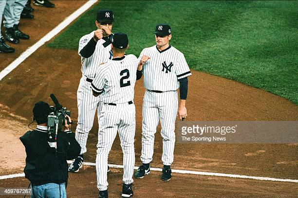 Derek Jeter Joe Torre and Chuck Knoblauch of the New York Yankees line up prior to Game One of the World Series against the New York Mets on October...