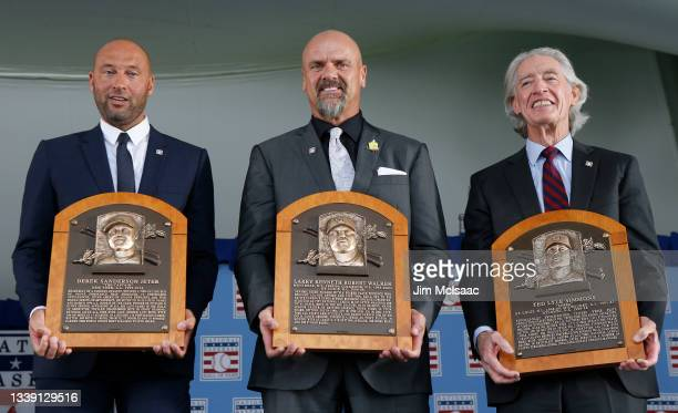 Derek Jeter, Larry Walker and Ted Simmons pose for a photograph with their plaques during the Baseball Hall of Fame induction ceremony at Clark...