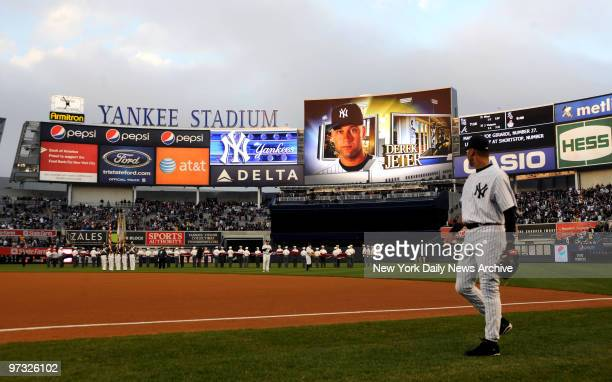 Derek Jeter looks at his photo on the jumbotron as lineups are introduced before the Yankees take on the Cubs in an exhibition game at the new Yankee...