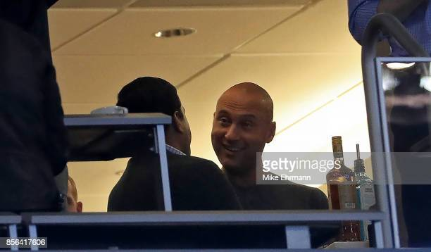 Derek Jeter looks on from the owners suite during a game against the Atlanta Braves at Marlins Park on October 1 2017 in Miami Florida