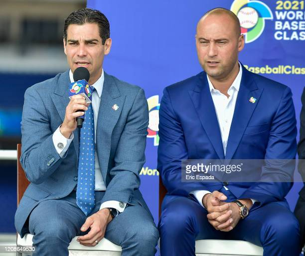 Derek Jeter of the Miami Marlins looks on as the City of Miami Mayor Francis X Suarez answers a question during the press conference to announce the...