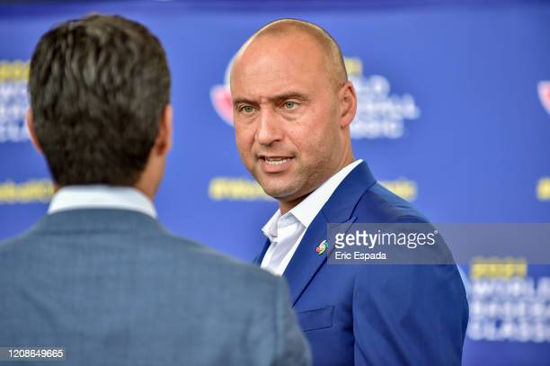 Derek Jeter of the Miami Marlins speaks to City of Miami Mayor Francis X Suarez after the press conference to announce the World Baseball Classic...