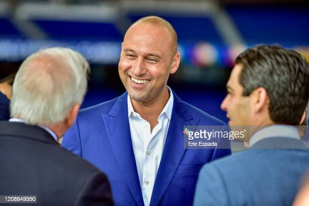Derek Jeter of the Miami Marlins talks to Carlos A Gimenez and Francis X Suarez before the press conference to announce the World Baseball Classic...