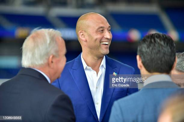 Derek Jeter of the Miami Marlins talks to Carlos A Gimenez and Francis X Suarez before the press conference to announce all three rounds of the World...