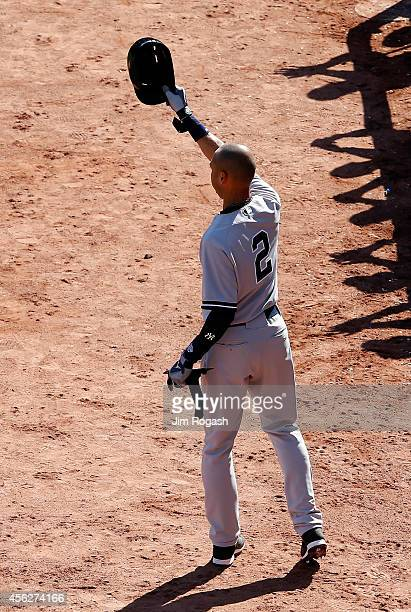 Derek Jeter of the New York Yankees acknowledges the crowd after hitting a single for his last career at bat in the third inning against the Boston...