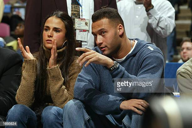 Derek Jeter of the New York Yankees and actress Jordana Brewster sit courtside as the Los Angeles Lakers take on the New Jersey Nets at Continental...