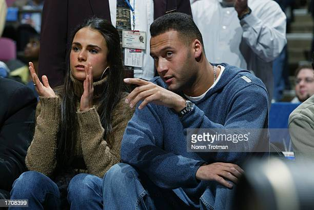 Derek Jeter of the New York Yankees and actress Jordana Brewster sit courtside as the Los Angeles Lakers take on the New Jersey Nets during the game...