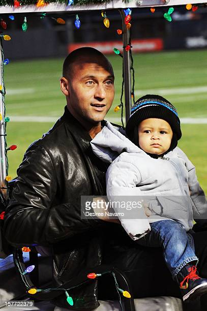 Derek Jeter of the New York Yankees and his nephew Jalen Jeter attend the 2012 Derek Jeter's Turn 2 Holiday Express at Yankee Stadium on December 5...