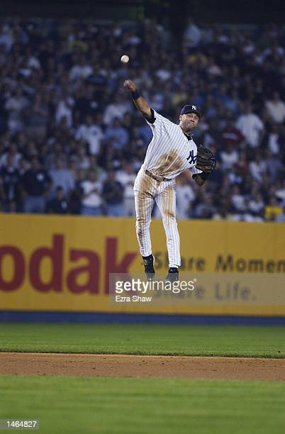 Derek Jeter of the New York Yankees attempts to make a throw to first during their game against the Anaheim Angels during Game 2 of the American...