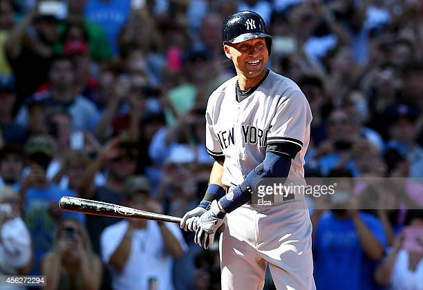 Derek Jeter of the New York Yankees bats against the Boston Red Sox in the first inning during the last game of the season at Fenway Park on...