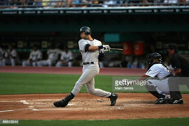 Derek Jeter of the New York Yankees bats against the Florida Marlins at Landshark Stadium on June 19 2009 in Miami Florida The Yankees defeated the...