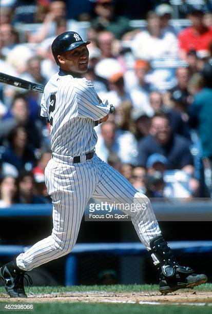 Derek Jeter of the New York Yankees bats during an Major League Baseball game circa 2002 at Yankee Stadium in the Bronx borough of New York City...