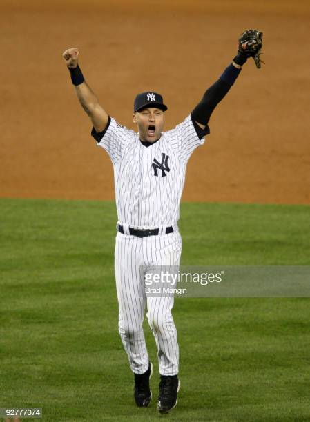 Derek Jeter of the New York Yankees celebrates after a 73 win against the Philadelphia Phillies in Game Six of the 2009 MLB World Series at Yankee...