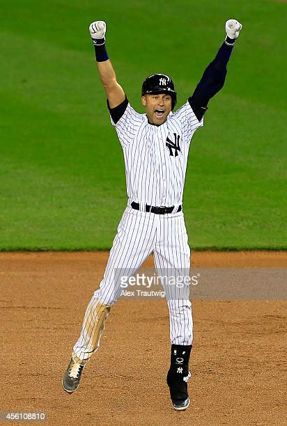 Derek Jeter of the New York Yankees celebrates after a game winning RBI hit in the ninth inning against the Baltimore Orioles in his last game ever...