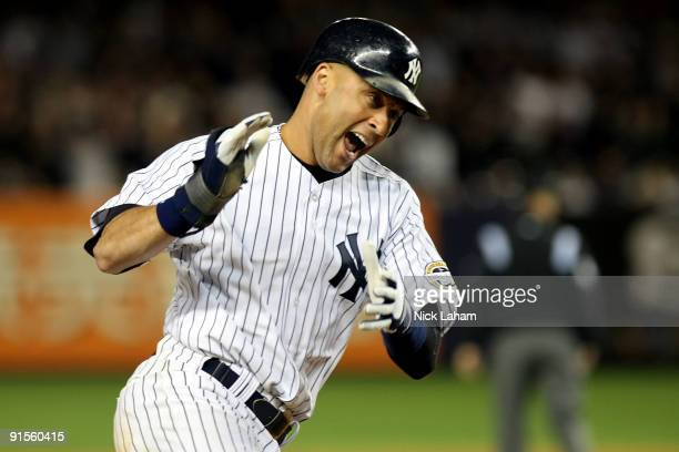 Derek Jeter of the New York Yankees celebrates after being brought home to score on a RBI single by Alex Rodriguez in the fifth inning against the...