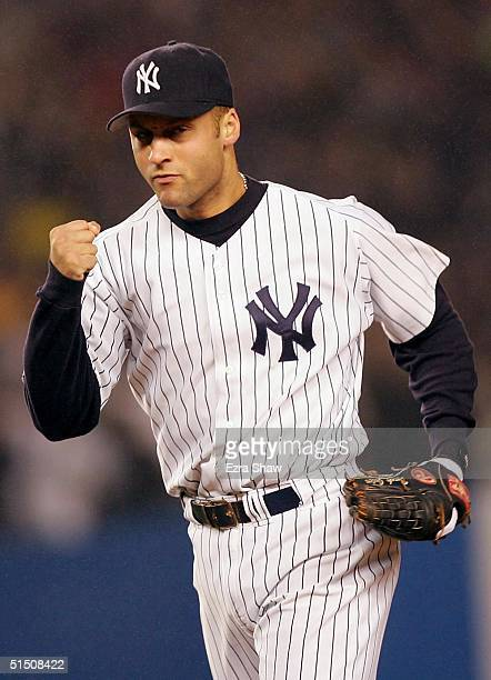 Derek Jeter of the New York Yankees celebrates after completing a double-play to end the second inning against the Boston Red Sox during game six of...