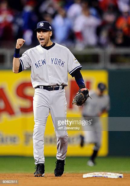 Derek Jeter of the New York Yankees celebrates after the final out of their 74 win against the Philadelphia Phillies in Game Four of the 2009 MLB...