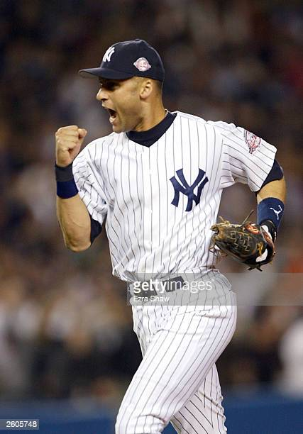 Derek Jeter of the New York Yankees celebrates after turning a double play to end the eighth inning against the Boston Red Sox during game 7 of the...