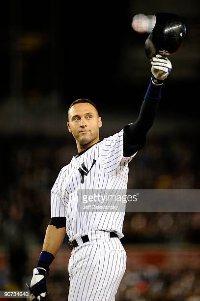 Derek Jeter of the New York Yankees celebrates his single to right field in the third inning during a game against the Baltimore Orioles at Yankee...