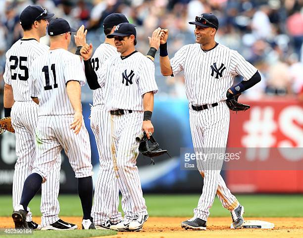 Derek Jeter of the New York Yankees celebrates the win with teammates Brian RobertsJacoby EllsburyBrett Gardner and Mark Teixeira after the win over...