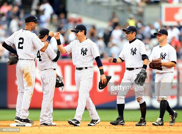 Derek Jeter of the New York Yankees celebrates the win with teammates Jacoby Ellsbury Brian RobertsIchiro Suzuki and Brett Gardner after the win over...