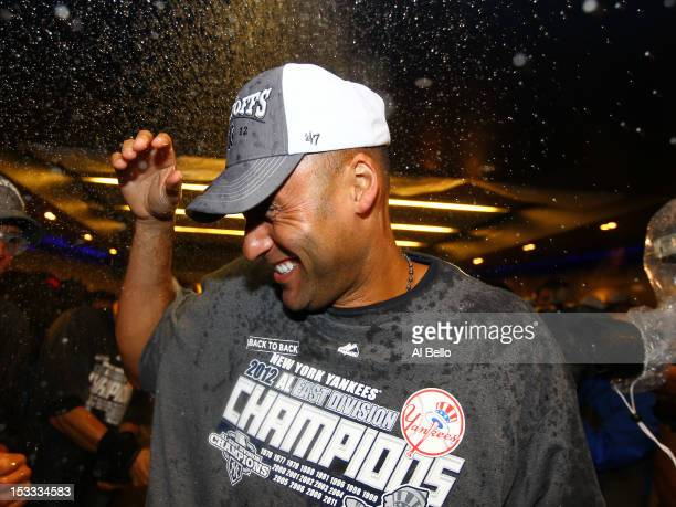 Derek Jeter of the New York Yankees celebrates winning the American League East Division Championship after their 142 win against the Boston Red Sox...