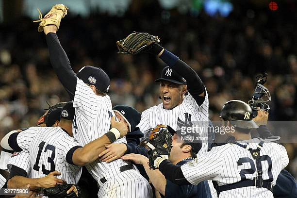 Derek Jeter of the New York Yankees celebrates with his teammates after their 73 win against the Philadelphia Phillies in Game Six of the 2009 MLB...