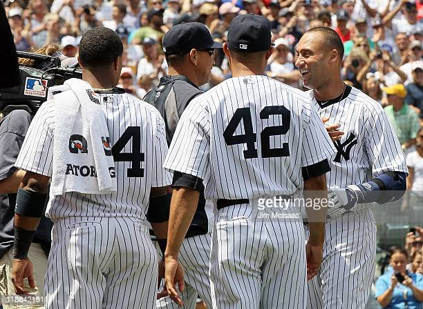 Derek Jeter of the New York Yankees celebrates with teammates Alex Rodriguez Robinson Cano and Mariano Rivera after career hit number 3 a third...