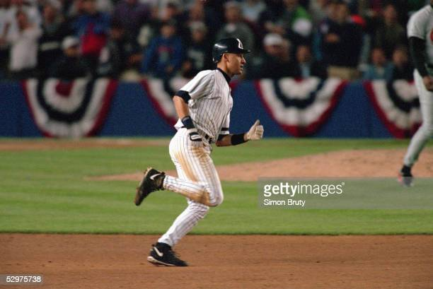 Derek Jeter of the New York Yankees circles the bases after hitting a controversial home run in the eighth inning of Game one of the 1996 American...