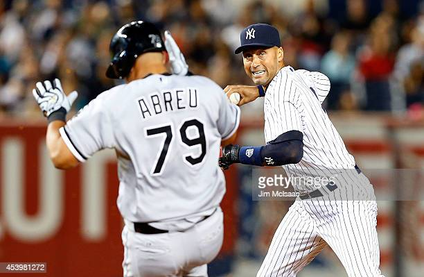 Derek Jeter of the New York Yankees completes a seventh inning double play after forcing out Jose Abreu of the Chicago White Sox at Yankee Stadium on...
