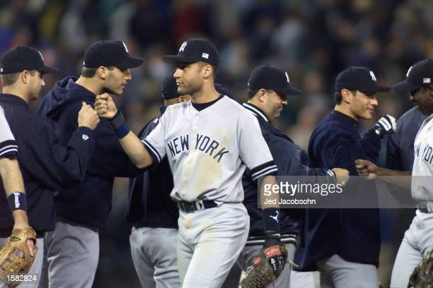 Derek Jeter of the New York Yankees congratulates his team after game two of the American League Championship Series against the Seattle Mariners on...