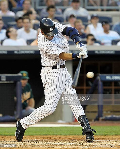 Derek Jeter of the New York Yankees connects on a second inning two run single against the Oakland Athletics on July 22 2011 at Yankee Stadium in the...