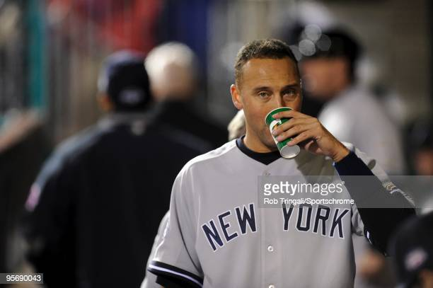 Derek Jeter of the New York Yankees drinks in the dugout against the Philadelphia Phillies in Game Five of the 2009 MLB World Series at Citizens Bank...