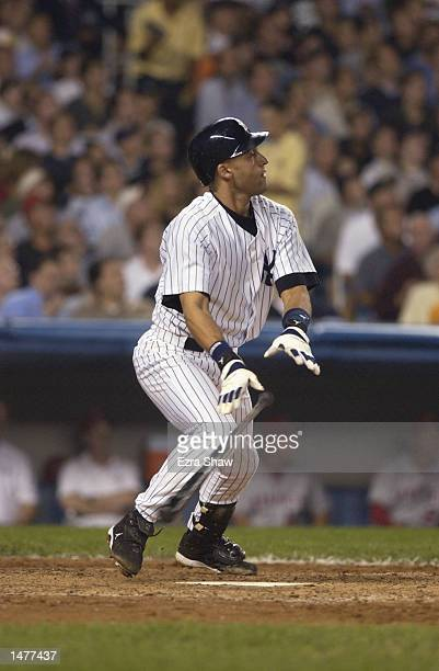 Derek Jeter of the New York Yankees drops his bat to run to first during game two of the American League Division Series against the Anaheim Angels...