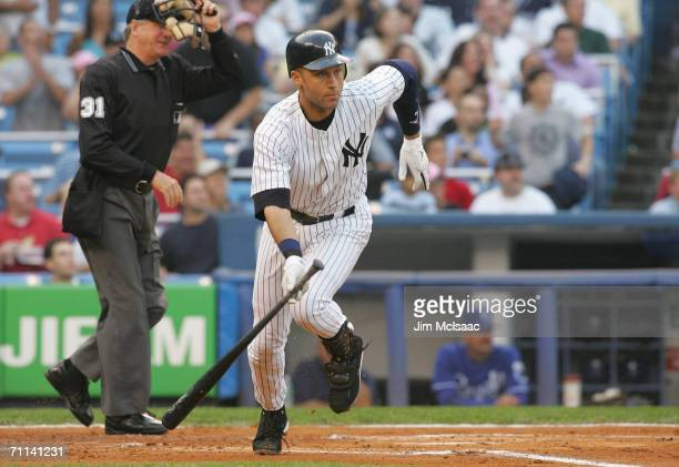 Derek Jeter of the New York Yankees drops the bat to run after his hit during the game against the Kansas City Royals at Yankee Stadium on May 26...