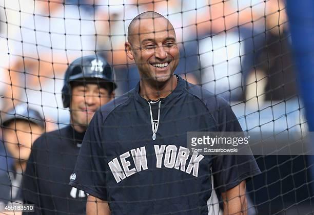 Derek Jeter of the New York Yankees during batting practice with Ichiro Suzuki behind him before the start of MLB game action against the Toronto...