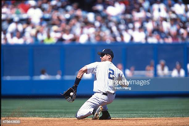 Derek Jeter of the New York Yankees fields a ground ball during a game at Yankee Stadium Circa 2002 in the Bronx borough of New York City New York