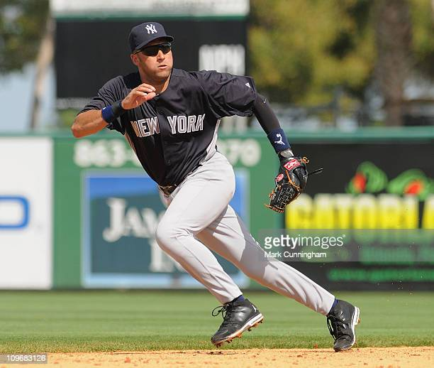 Derek Jeter of the New York Yankees fields against the Detroit Tigers during the spring training game at Joker Marchant Stadium on February 28 2011...