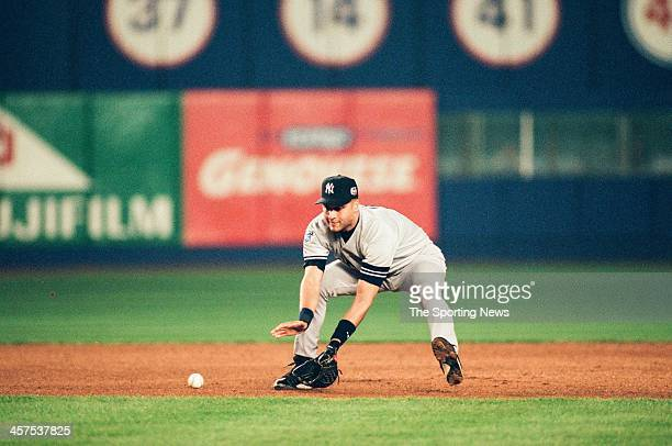 Derek Jeter of the New York Yankees fields during Game Five of the World Series against the New York Mets on October 26 2000 at Shea Stadium in...