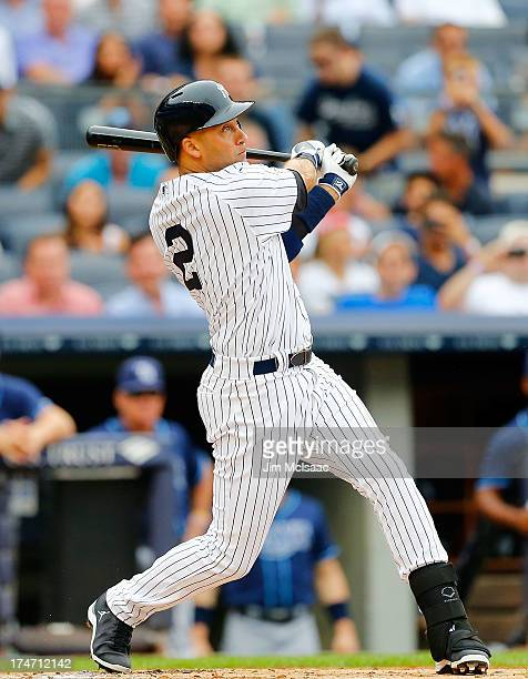 Derek Jeter of the New York Yankees follows through on a first inning home run against the Tampa Bay Rays at Yankee Stadium on July 28 2013 in the...