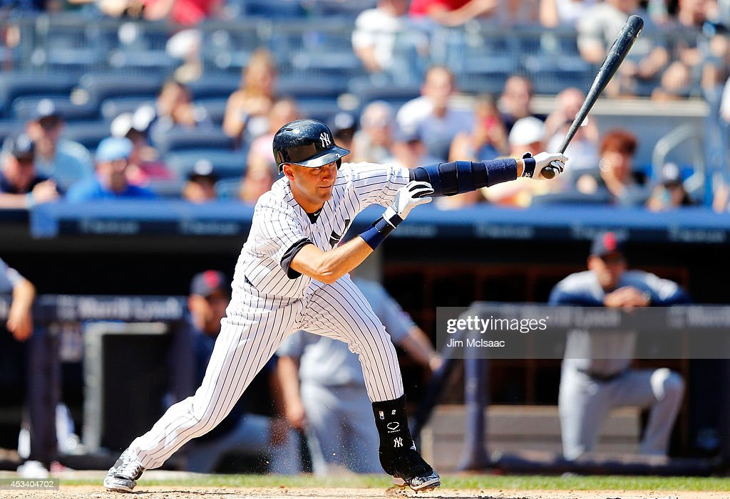 Derek Jeter #2 of the New York Yankees follows through on a sixth inning infield base hit against the Cleveland Indians at Yankee Stadium on August 9, 2014 in the Bronx borough of New York City. The single was Jeter's 3,431st career hit moving him past Honus Wagner and into sixth on the all-time hit list. The Indians defeated the Yankees 3-0.