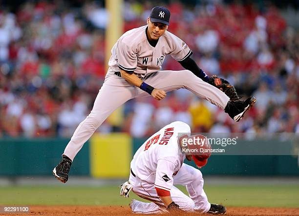 Derek Jeter of the New York Yankees forces Jeff Mathis of the Los Angeles Angels of Anaheim out at second base during the second inning in Game Five...