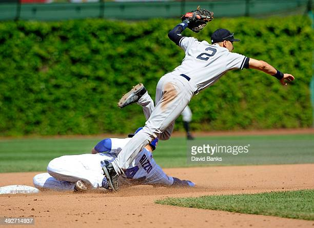 Derek Jeter of the New York Yankees forces out Anthony Rizzo of the Chicago Cubs during the seventh inning on May 21 2014 at Wrigley Field in Chicago...