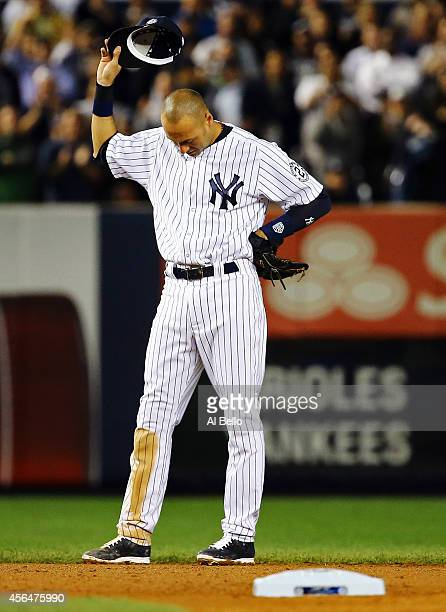 Derek Jeter of the New York Yankees gestures from the field against the Baltimore Orioles in his last game ever at Yankee Stadium on September 25...