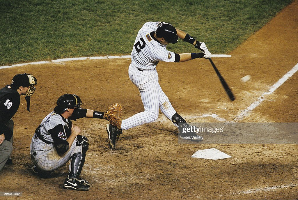 Derek Jeter of the New York Yankees hits a game winning home run in the bottom of the tenth inning off of Byun-Hyun Kim during game four of the World Series against the Arizona Diamondbacks at Yankee Stadium on November 1, 2001 in Bronx, New York. The Yankees defeated the Diamondbacks 4-3.