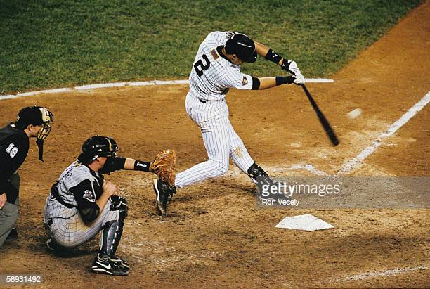 Derek Jeter of the New York Yankees hits a game winning home run in the bottom of the tenth inning off of ByunHyun Kim during game four of the World...