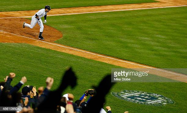 Derek Jeter of the New York Yankees hits a game winning RBI hit in the ninth inning against the Baltimore Orioles in his last game ever at Yankee...